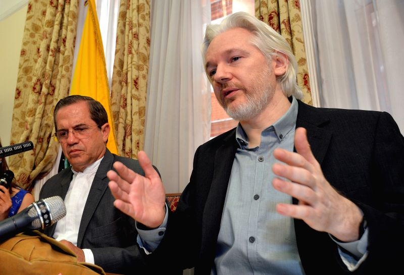 WikiLeaks founder Julian Assange (R) and Ecuadorian Foreign Minister Ricardo Patino attend a press conference at the Ecuadorian Embassy in London, Britain, Aug. 18, - Ricardo Patino
