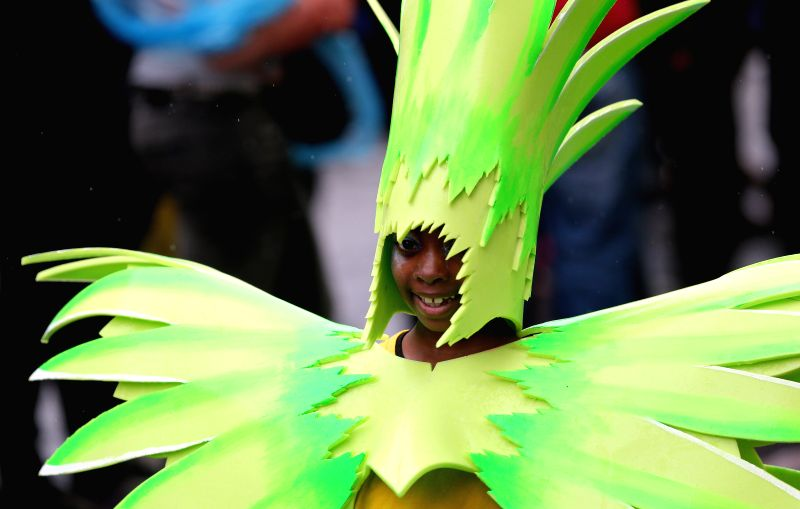 A performer dances during the Notting Hill Carnival in London, Britain on Aug. 25, 2014. Over 1 million visitors are expected to attend the two-day event which is ...