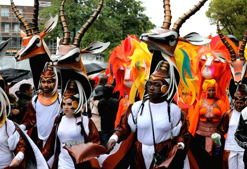Performers parade during the Notting Hill Carnival in London, Britain, on Aug. 25, 2014. Over 1 million visitors are expected to attend the two-day event which is ...