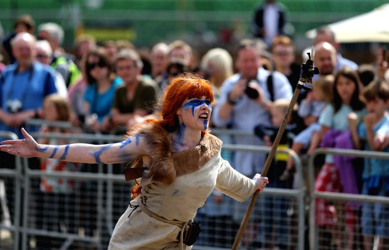 """A actress performs """"Boudicca vs the Romans"""" at Battle Bridge Place and Granary Square, King's Cross, in London, Britain, on Aug. 30, 2014. An outdoor event"""