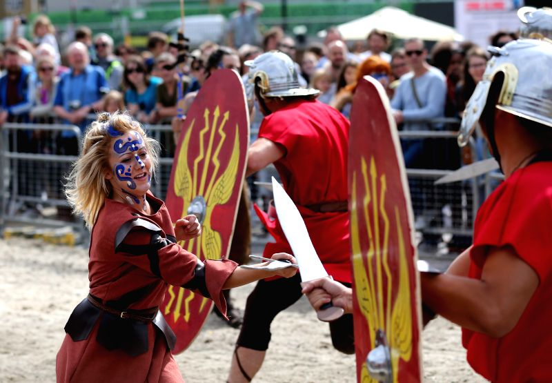 """Actors perform """"Boudicca vs the Romans"""" at Battle Bridge Place and Granary Square, King's Cross, in London, Britain, on Aug. 30, 2014. An outdoor event ..."""