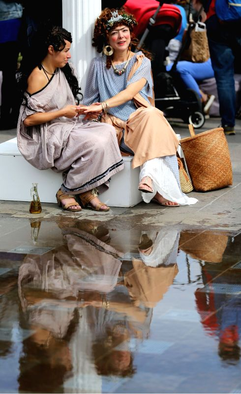 """Actresses are seen during """"Boudicca vs the Romans"""" at Battle Bridge Place and Granary Square, King's Cross, in London, Britain, on Aug. 30, 2014. An ..."""