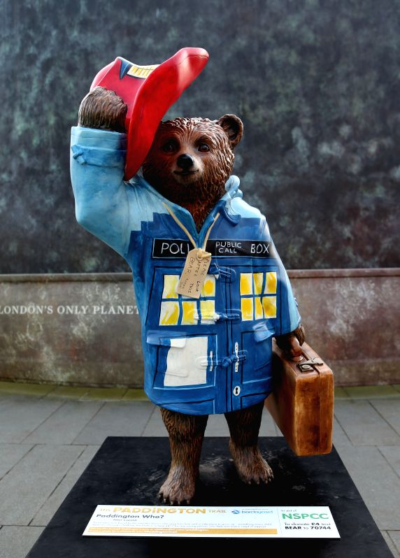 Photo taken on Nov. 19, 2014 shows a Paddington Bear statue in Greenwich in London, Britain. Paddington Bear is a fictional character in children's literature. The ..