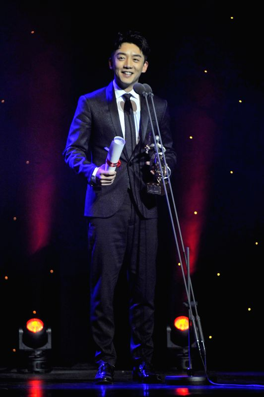 LONDON, Dec. 7, 2017 - Actor Zheng Kai speaks after receiving the Committee Golden Knight Award at the 5th China Britain Film Festival 2017 awards ceremony in London, Britain, on Dec. 6, 2017. - Zheng Kai