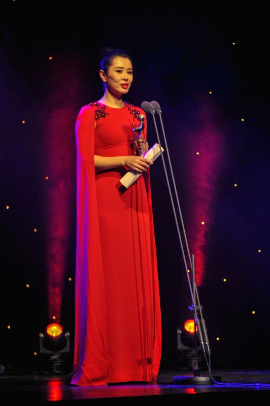 LONDON, Dec. 7, 2017 - Actress Yu Nan speaks after receiving the Best Actress Award at the 5th China Britain Film Festival 2017 awards ceremony in London, Britain, on Dec. 6, 2017. - Y
