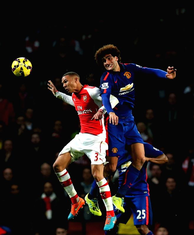 London (England): Kieran Gibbs (L) of Arsenal heads for the ball with Marouane Fellaini of Manchester United during the Barclays Premier League match between Arsenal and Manchester United at Emirates