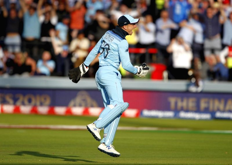 London: England's Jos Buttler dismisses Martin Guptill in the last ball of the super over to win the 2019 World Cup at Lord's Cricket Ground in London on July 15, 2019. (Photo: Surjeet Yadav/IANS)