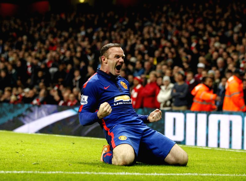 London (England): Wayne Roony of Manchester United celebrates after scoring during the Barclays Premier League match between Arsenal and Manchester United at Emirates Stadium in London, on Nov. 22, ..