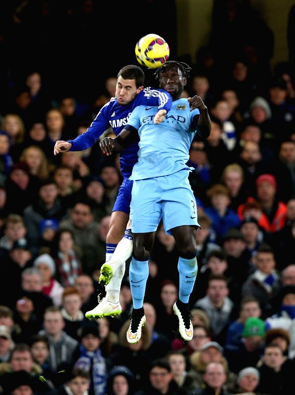 Bacary Sagna (R) of Manchester City heads for the ball with Eden Hazard of Chelsea during the Barclays Premier League match between Chelsea and Manchester City at ...