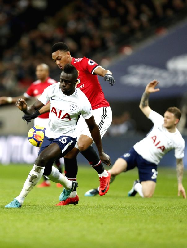 LONDON, Feb. 1, 2018 - Anthony Martial (2nd R) of Manchester United vies with Davinson Sanchez of Tottenham Hotspur during the English Premier League football match between Tottenham Hotspur and ...