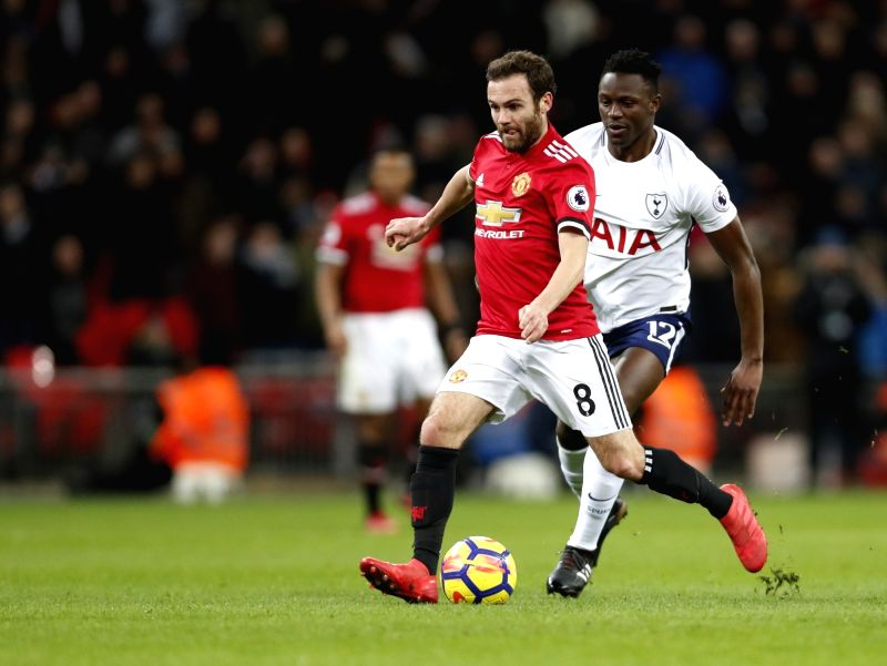 LONDON, Feb. 1, 2018 - Juan Mata (L) of Manchester United vies with Victor Wanyama of Tottenham Hotspur during the English Premier League football match between Tottenham Hotspur and Manchester ...
