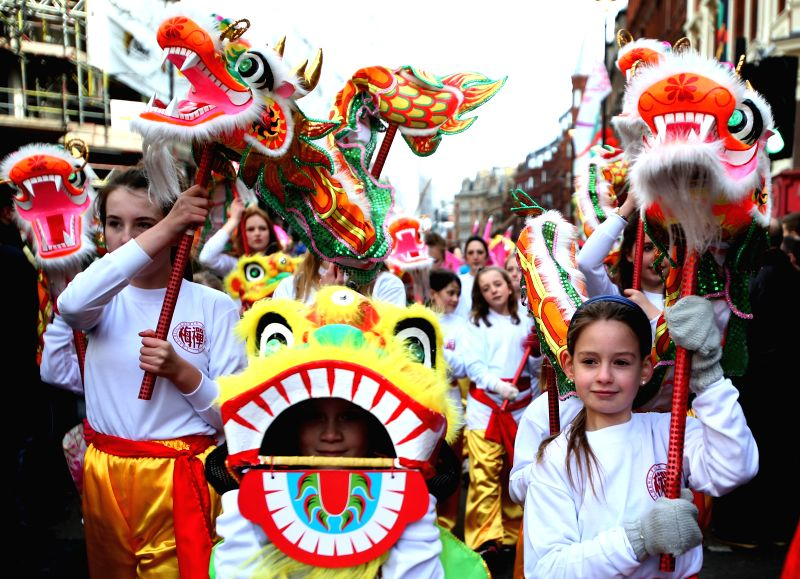 Foreign performers take part in a parade to celebrate the Chinese Lunar New Year in the streets of central London, Britain, on Feb. 22, 2015.