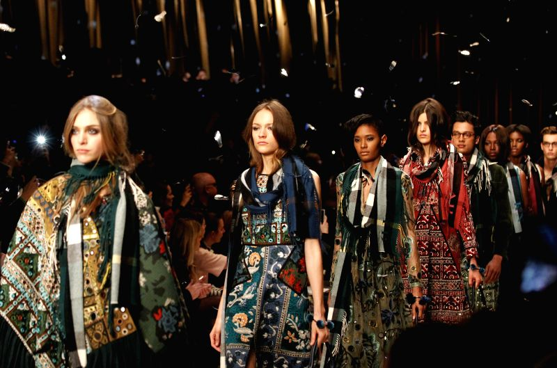 Models walk the runway at the Burberry Prosum show during London Fashion Week Fall/Winter 2015 at Perk's Field, Kensington Gardens in London, Britain, on Feb. 23, ...