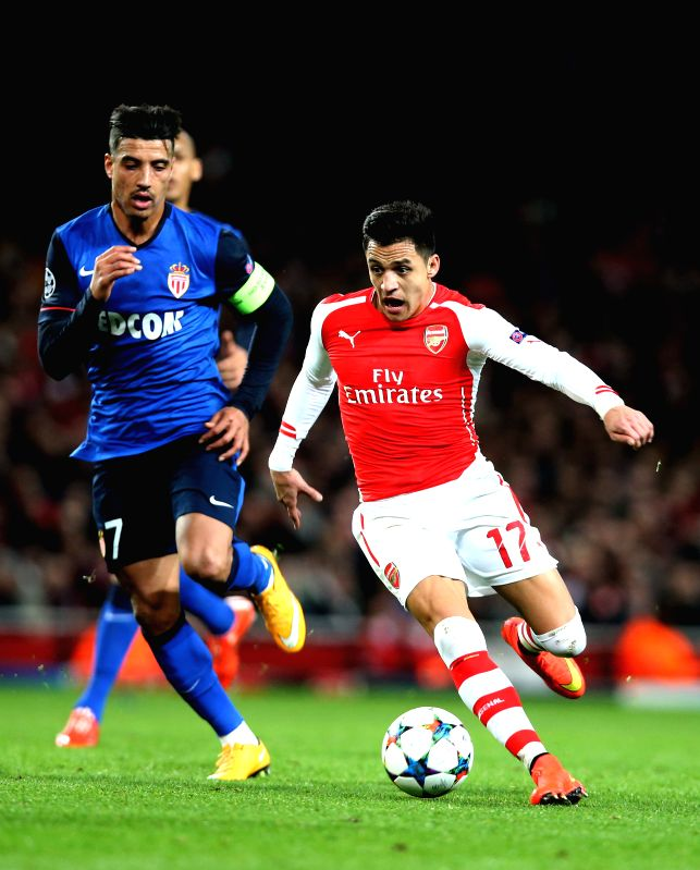 Alexis Sanchez (R) of Arsenal breaks through during the UEFA Champions league Round of 16 first leg match between Arsenal and Monaco at the Emirates Stadium in ...
