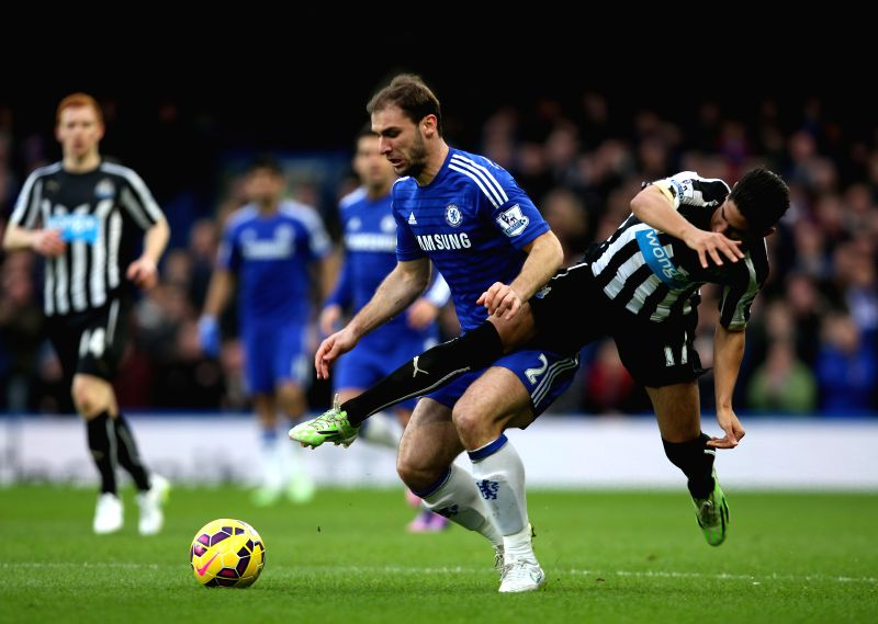 Branislav Ivanovic (Front L) of Chelsea vies with Ayoze Perez of Newcastle United during the Barclays Premier League match between Chelsea and Newcastle United at ...