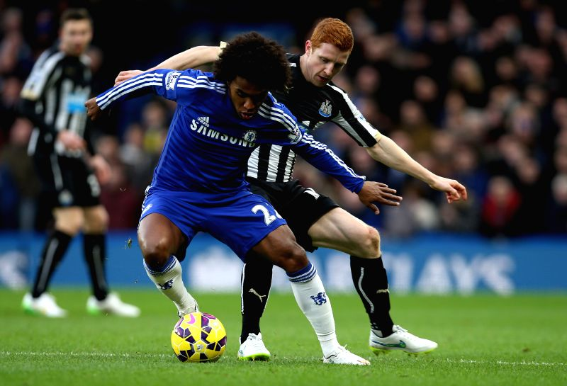 Willian (L) of Chelsea vies with Jack Colback of Newcastle United during the Barclays Premier League match between Chelsea and Newcastle United at Stamford Bridge in