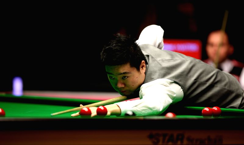 Ding Junhui of China competes during the 2015 Snooker Masters first round match against Joe Perry of England at Alexandra Palace in London, Great Britain, on Jan.14,