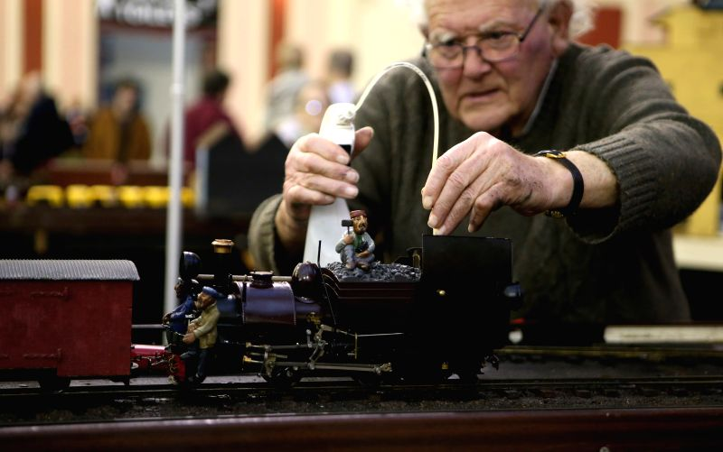A hobbiest adds water to a train model during the London Model Engineering Exhibition at the Alexandra Palace in London, Britain, on Jan. 17, 2015. The three-day ...