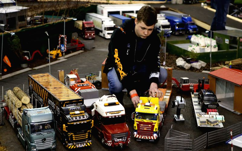 A hobbiest arranges remote control trucks during the London Model Engineering Exhibition at the Alexandra Palace in London, Britain, on Jan. 17, 2015. The three-day .