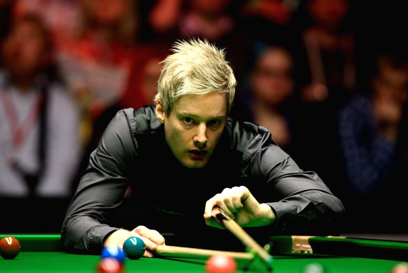 Neil Robertson of Australia competes during the 2015 Snooker Masters semifinal against Ronnie O'Sullivan of England at the Alexandra Palace in London, capital of ...