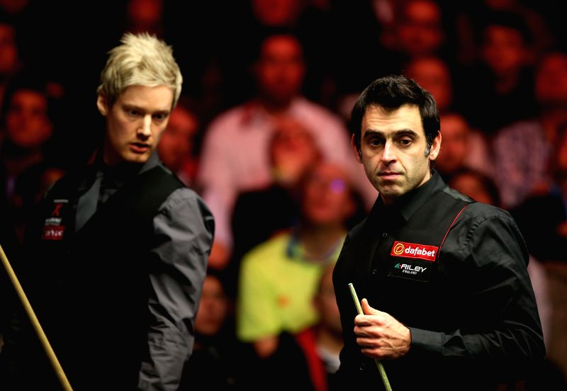 Ronnie O'Sullivan (R) of England and Neil Robertson of Australia react during the 2015 Snooker Masters semifinal at the Alexandra Palace in London, capital of ...