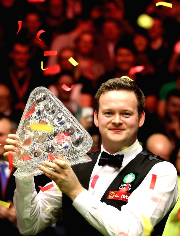 Shaun Murphy of England celebrates with his trophy after winning the 2015 Snooker Masters final against Neil Robertson of Australia at the Alexandra Palace in ...