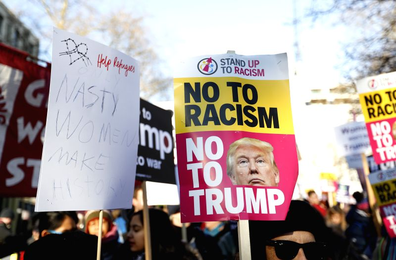 LONDON, Jan. 21, 2017 - Protesters hold placards during the Women's March in London, England on Jan.  21, 2017. The Women's March originated in Washington DC but soon spread to be a global march ...