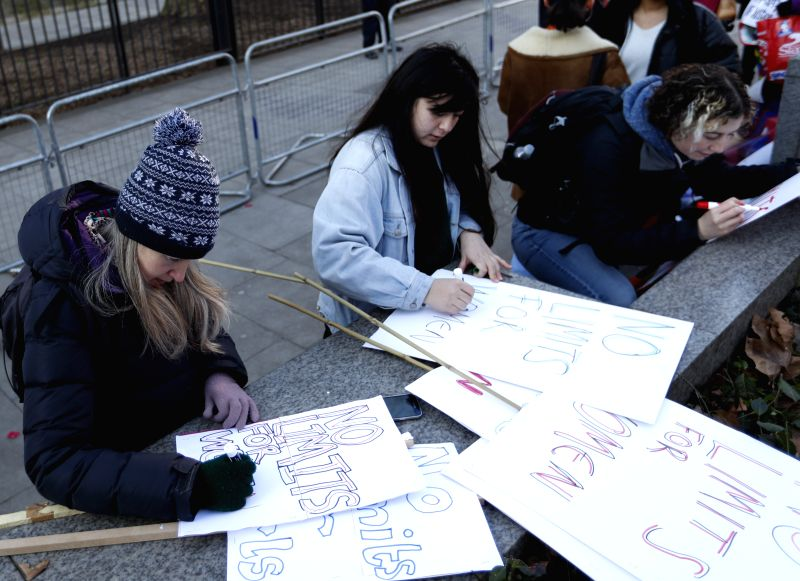 LONDON, Jan. 21, 2017 - Protesters write placards ahead of the Women's March in London, England on Jan.  21, 2017. The Women's March originated in Washington DC but soon spread to be a global march ...