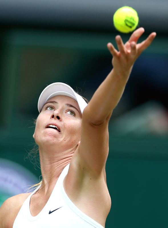 Russia's Maria Sharapova serves during the women's singles fourth round match against Germany's Angelique Kerber at the 2014 Wimbledon Championships in Wimbledon, ...