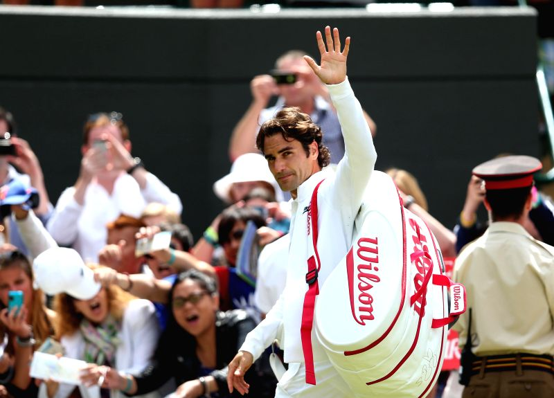 Switzerland's Roger Federer gestures to spectators as he leaves the court after the men's singles fourth round match against Spain's Tommy Robredo at the 2014 ...
