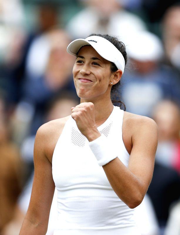 LONDON, July 11, 2017 - Garbine Muguruza of Spain celebrates after winning the women's singles quarter-finals match with Svetlana Kuznetsova of Russia during Day 8 of the Wimbledon Championship 2017 ...