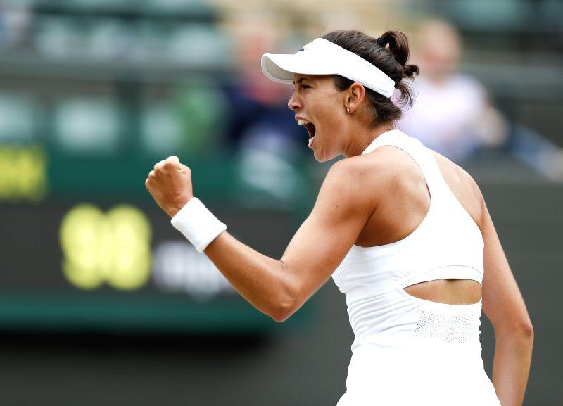 LONDON, July 11, 2017 - Garbine Muguruza of Spain celebrates during the women's singles quarter-finals match with Svetlana Kuznetsova of Russia during Day 8 of the Wimbledon Championship 2017 at ...
