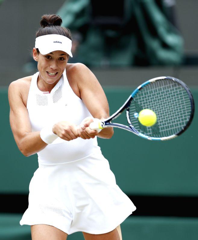 LONDON, July 11, 2017 - Garbine Muguruza of Spain competes during the women's singles quarter-finals match with Svetlana Kuznetsova of Russia during Day 8 of the Wimbledon Championship 2017 at ...