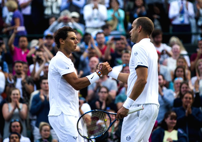 LONDON, July 11, 2017 - Rafael Nadal (L) of Spain greets Gilles Muller of Luxembourg after their men's singles fourth round match at the Championship Wimbledon 2017 in London, Britain on July 10, ...