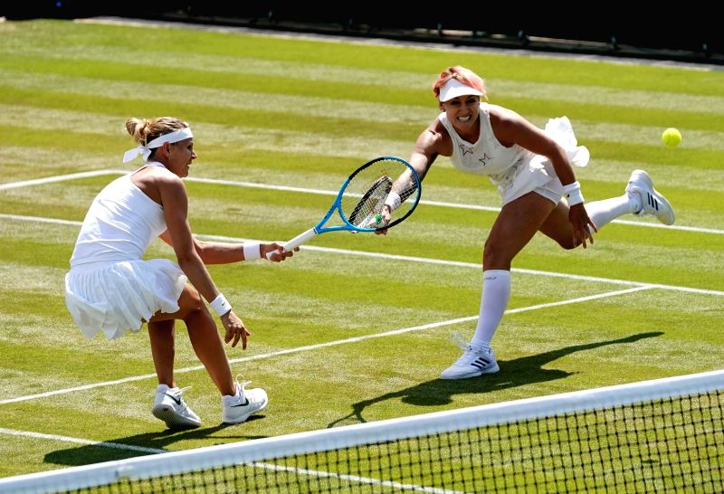 LONDON, July 11, 2018 - Bethanie Mattek-Sands (R) of the United States and Lucie Safarova of Czech Republic compete during the women's doubles quarter-finals match against Xu Yifan of China and ...