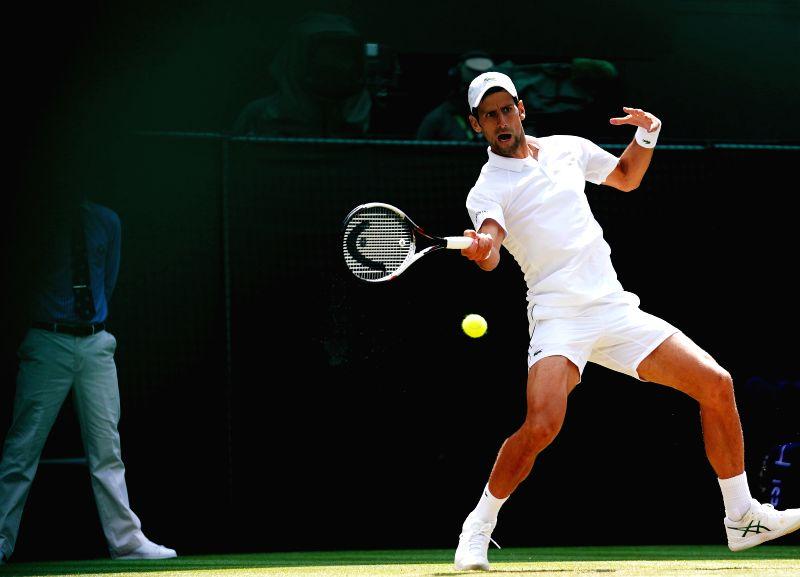 LONDON, July 11, 2018 - Novak Djokovic of Serbia hits a return during the men's singles quarterfinal match against Kei Nishikori of Japan at the Wimbledon Championships 2018 in London, Japan, on July ...