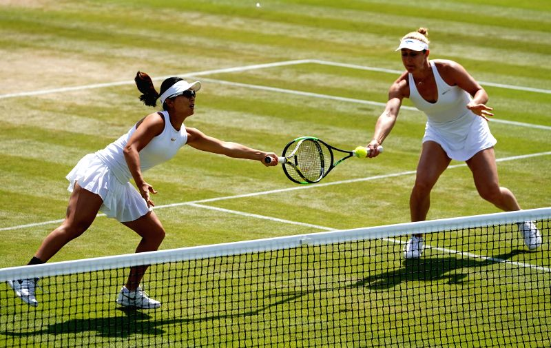 LONDON, July 11, 2018 - Xu Yifan (L) of China and Gabriela Dabrowski of Canada compete during the women's doubles quarter-finals match against Bethanie Mattek-Sands of the United States and Lucie ...
