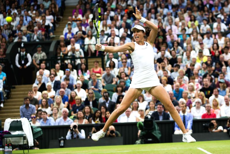 LONDON, July 12, 2017 - Johanna Konta of Britain returns the ball during the women's singles quarterfinal with Simona Halep of Romania at the Championship Wimbledon 2017 in London, Britain on July ...