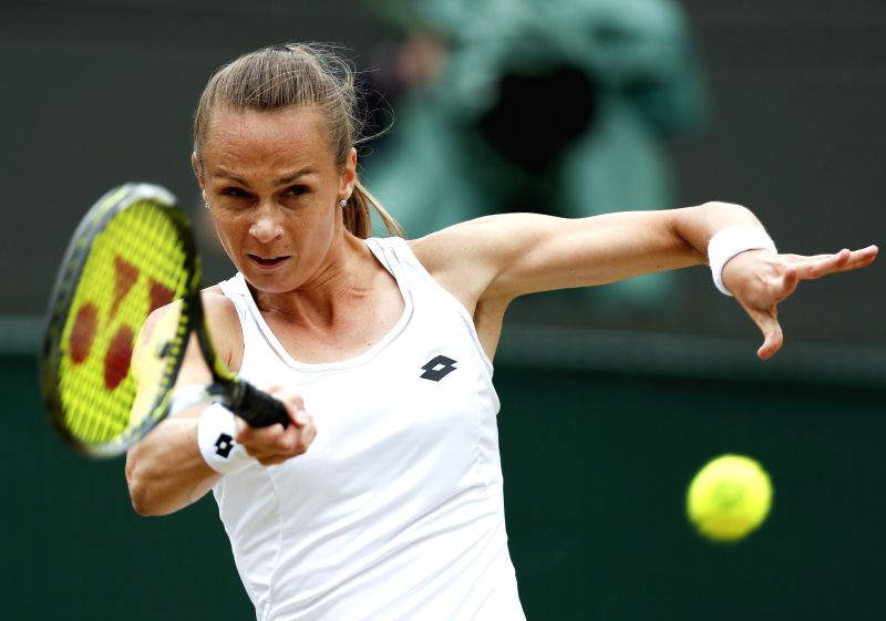 LONDON, July 12, 2017 - Magdalena Rybarikova of Slovakia returns the ball during the women's singles quarterfinal with Coco Vandeweghe of the United States at the Championship Wimbledon 2017 in ...