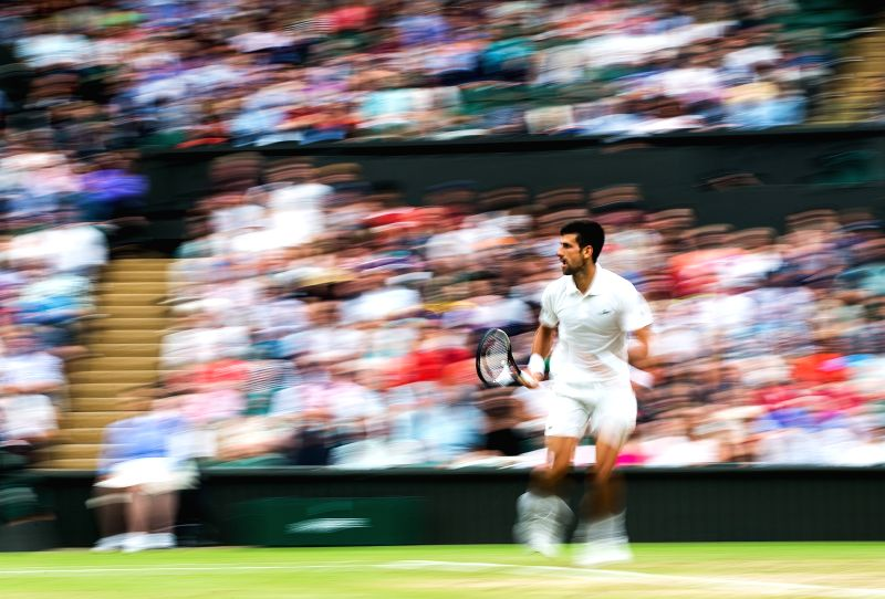 LONDON, July 12, 2017 - Novak Djokovic of Serbia returns the ball during the men's singles fourth round match with Adrian Mannarino of France at the Championship Wimbledon 2017 in London, Britain on ...