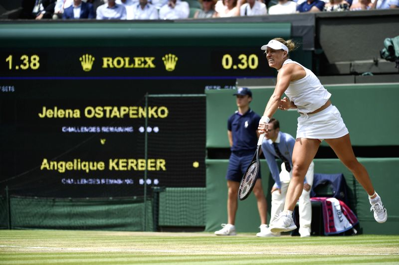 LONDON, July 12, 2018 - Angelique Kerber of Germany serves during the ladies' singles semi-final match against Jelena Ostapenko of Latvia at the Wimbledon Championships 2018 in London, Britain, on ...