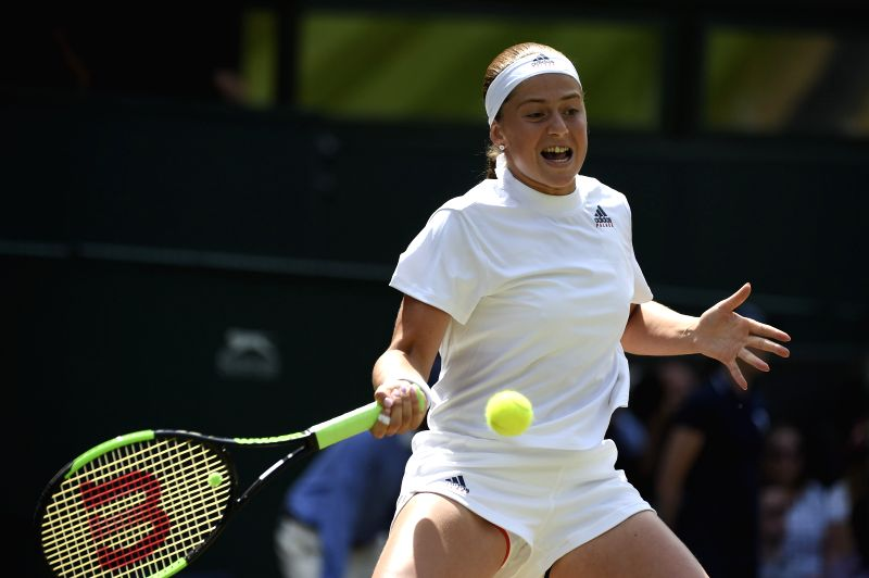LONDON, July 12, 2018 - Jelena Ostapenko of Latvia hits a return during the ladies' singles semi-final match against Angelique Kerber of Germany at the Wimbledon Championships 2018 in London, ...