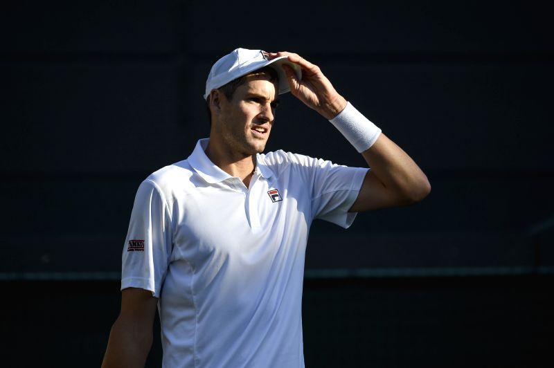 LONDON, July 12, 2018 - John Isner of the United States reacts during the men's singles quarterfinal match against Milos Raonic of Canada at the Wimbledon Championships 2018 in London, Britain, July ...