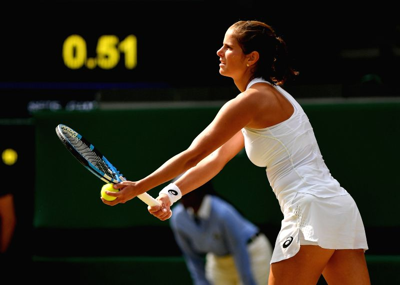 LONDON, July 13, 2018 - Julia Goerges of Germany serves during the women's singles semifinal match against Serena Williams of the United States at the Championship Wimbledon 2018 in London, Britain, ...