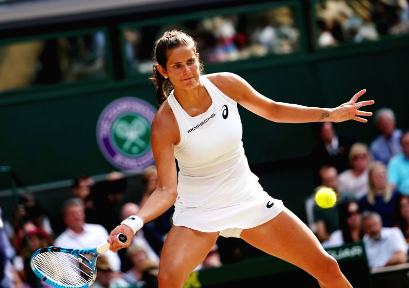 LONDON, July 13, 2018 - Julia Goerges of Germany hits a return during the women's singles semifinal match against Serena Williams of the United States at the Championship Wimbledon 2018 in London, ...