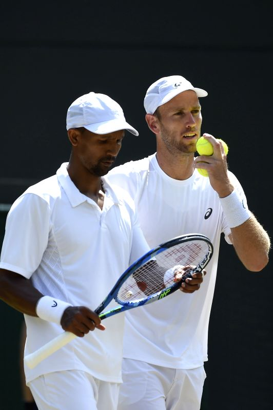 LONDON, July 13, 2018 - Raven Klaasen (L) of South Africa and Michael Venus of New Zealand compete during the men's doubles semifinal match against Frederik Nielsen of Denmark and Joe Salisbury of ...