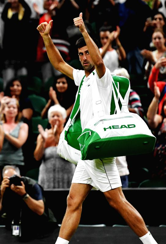 LONDON, July 14, 2018 - Novak Djokovic of Serbia greets spectators after suspension of the men's singles semifinal match against Rafael Nadal of Spain at the Wimbledon Championships 2018 in London, ...