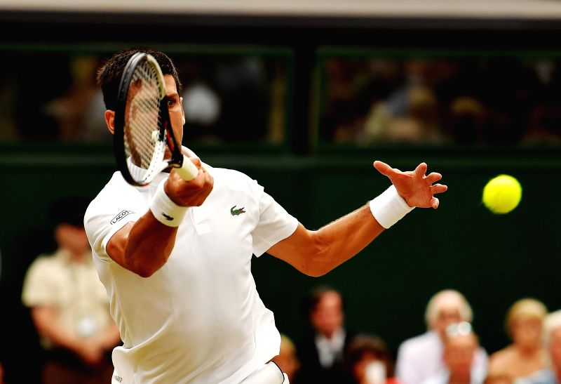 LONDON, July 14, 2018 - Novak Djokovic of Serbia returns the ball during the men's singles semifinal match against Rafael Nadal of Spain at the Wimbledon Championships 2018 in London, Britain, on ...