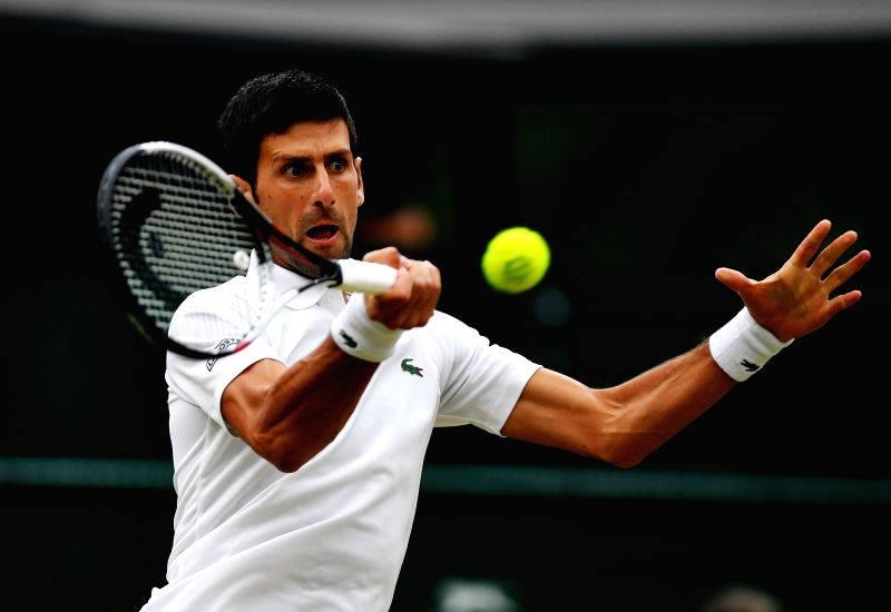 LONDON, July 14, 2018 - Novak Djokovic of Serbia hits a return during the men's singles semifinal match against Rafael Nadal of Spain at the Wimbledon Championships 2018 in London, Britain, on July ...