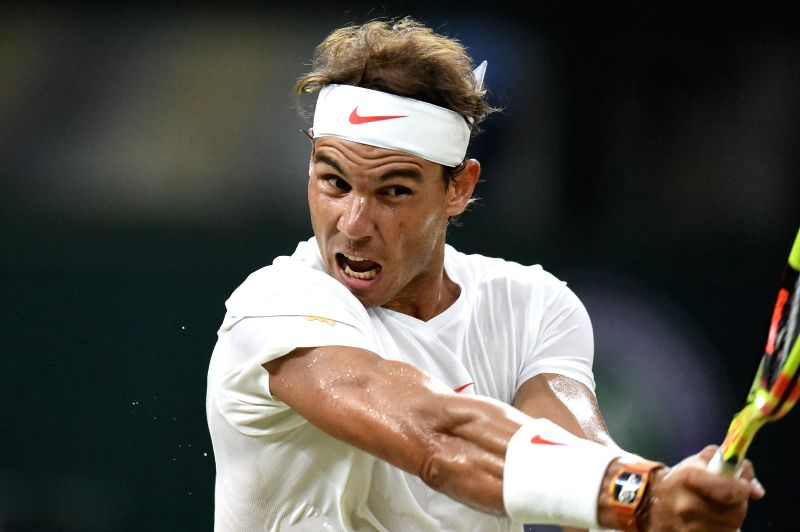 LONDON, July 14, 2018 - Rafael Nadal of Spain hits a return during the men's singles semifinal match against Novak Djokovic of Serbia at the Wimbledon Championships 2018 in London, Britain, on July ...